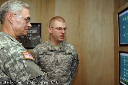 Army Chief Lt. Gen. Jeffrey A. Sorenson, Army chief information officer, talks about network operations with Staff Sgt. Matthew Spire, 2-3 Brigade Troops Battalion, 2nd Brigade Combat Team, 3rd Infantry Division, NETOPS noncommissioned officer in charge, during a visit to Forward Operating Base Kalsu Jan. 19.