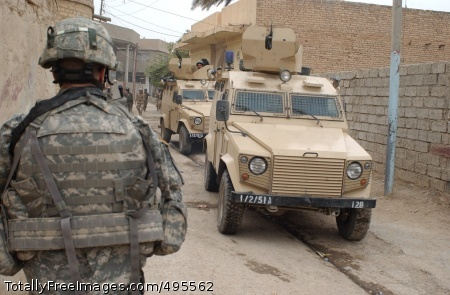 Caldwell: Iraqi Iraqi and U.S. Soldiers from the Military Transition Team patrol Buhriz in December.  Photo Credit: Jan 4, 2007