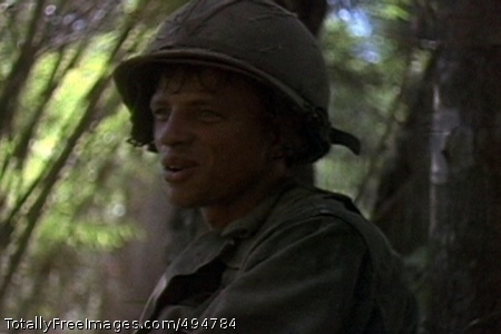 A Cavalryman at LZ A Soldier of the 1st Battalion, 7th Cavalry, during the fight for LZ X-Ray in the Ia Drang Valley of Vietnam.  Photo extracted from US Army motion picture footage. (Nov 1965)' Photo Credit: Feb 26, 2007