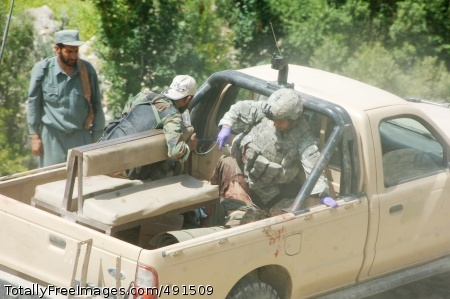 Counterattack at Sgt. Joseph Peer treats an Afghan soldier who was shot by the Taliban during the engagement. Photo Credit: Sep 14, 2007