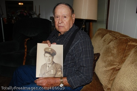 WWII vet remembers Former Sgt. Lawrence Lacy shows a photograph of himself during his Army years. Photo Credit: Oct 24, 2008