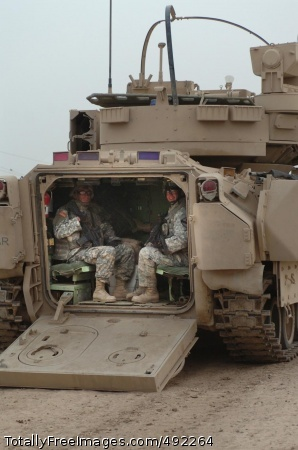 Sappers Rule the Soldiers in a Bradley fighting vehicle smile for the camera. Photo Credit: Aug 1, 2007