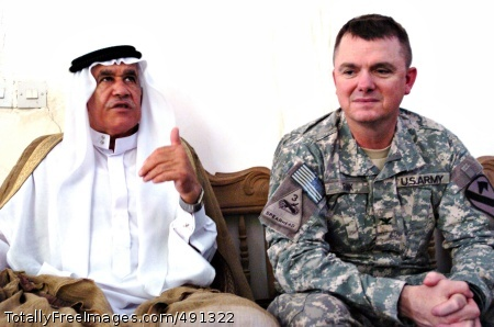 Abu Ghraib sheiks Roundup, Mont., native Col. Paul E. Funk II, commander of the 1st 'Ironhorse' Brigade Combat Team, 1st Cavalry Division, speaks with a local sheik in the village of Jubeb, near Abu Ghraib, Iraq Sept. 19. The meeting was part of a trend toward cooperation in Abu Ghraib, where an 'awakening' of Sunni sheiks sparked the growth of a homegrown security force. These citizens grew tired of the violence of Sunni extremists in the area and took up arms in support of the Coalition.  Photo Credit: Sep 24, 2007