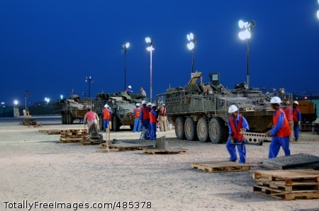 Kuwait team readies Contract workers with General Dynamics Land Systems work under the lights to remove slat armor from 4th Stryker Brigade Combat Team, 2nd Infantry Division, Stryker Combat Vehicles, Friday, May 30, 2008 at a 401st Army Field Support Brigade work area at Camp Arifjan, Kuwait. More than 280, 4th Brigade SCVs are being \'deslatted' in preparation for retrograde to the U.S. after 15 months of combat duty in Operation Iraqi Freedom.  Photo Credit: Jun 6, 2008