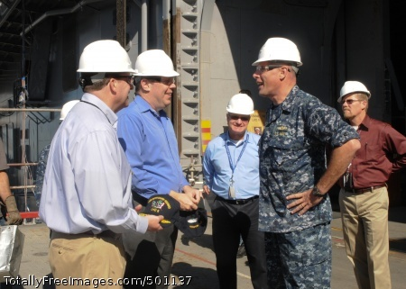 110503-N-7451A-007 SAN DIEGO (May 3, 2011) Kevin Cooley, Assistant Deputy Chief Management Officer for the Navy, Brian Marsh, head of the Communications and Networks Department, Space and Naval Warfare Systems Center Pacific, and Capt. Jonathan Harnden, commanding officer of the amphibious assault ship USS Bonhomme Richard (LHD 6), tour network and communications spaces to view the progress of new equipment being installed aboard the ship.  Bonhomme Richard recently completed a four-month dry dock period. (U.S. Navy photo by Mass Communication Specialist 1st Class Janell Alvarez/Released)