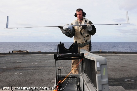 110226-N-RC734-107 PACIFIC OCEAN (Feb. 26, 2011) Jon Wingard, a Scan Eagle operator and maintainer from Insitu Group, places an Scan Eagle unmanned aerial vehicle on its stand aboard the amphibious dock landing ship USS Comstock (LSD 45). Scan Eagle is a runway independent, long-endurance, unmanned aerial vehicle system designed to provide multiple surveillance, reconnaissance data, and battlefield damage assessment missions. Comstock is part of the Boxer Amphibious Ready Group and is underway in the U.S. 7th Fleet area of responsibility. (U.S. Navy photo by Mass Communication Specialist 2nd Class Joseph M. Buliavac/Released)