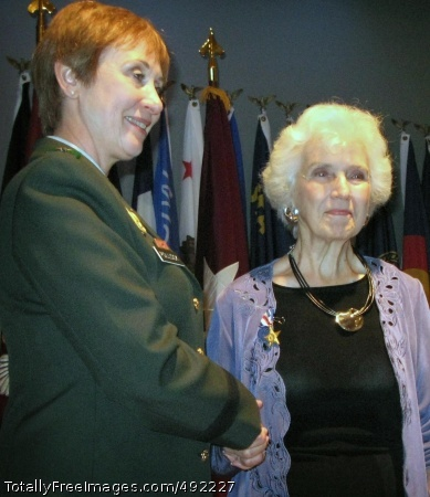 Daughter Accepts Maj. Gen. Gale S. Pollock, acting Army surgeon general and chief of the Army Nurse Corps, presents the Silver Star to Mary Jane Bolles Reed, who accepts it on behalf of her deceased mother, World War I Army nurse Linnie Leckrone, July 31. Photo Credit: Aug 2, 2007