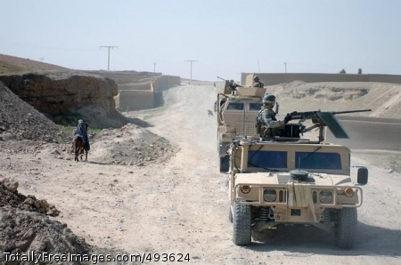 Uprooting Taliban Soldiers patrol Sangin City. Photo Credit: May 9, 2007