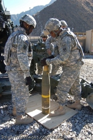 Excalibur Staff Sgt. Darius Scott (left) watches Staff Sgt. Jamare Cousar of C Battery, 3rd Battalion, 321st Field Artillery Regiment, use the Enhanced Portable Inductive Artillery Fuse Setter to program the proper grid coordinates into the GPS-guided Excalibur round before the first fire of the round at Camp Blessing, Afghanistan, Feb. 25. Photo Credit: Jun 17, 2008