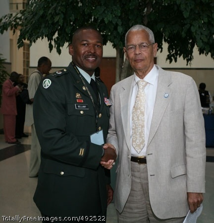 NAACP Delegates Capt. Andre Bellamy, USAREC Dearborn Company Commander, meets Julian Bond, Chairman, NAACP during the NAACP National Convention in Detriot, Mich. Photo Credit: Jul 13, 2007