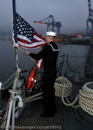 110707-N-NL541-228  VALPARAISO, Chile (July 7, 2011) Cryptologic Technician (Technical) 2nd Class James Holmes performs evening colors aboard the guided-missile frigate USS Thach (FFG 43) in Valparaiso, Chile. Thach is deployed supporting Southern Seas 2011. (U.S. Navy photo by Mass Communication Specialist 3rd Class Stuart Phillips/Released)