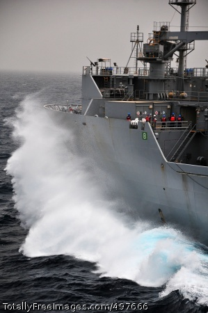 110711-N-ZS026-153 GULF OF ADEN (July 11, 2011) Waves crash against the bow of the Military Sealift Command dry cargo and ammunition ship USNS Alan Shepard (T-AKE 3) as it transits the Gulf of Aden. (U.S. Navy photo by Mass Communication Specialist 3rd Class Trevor Welsh/Released)