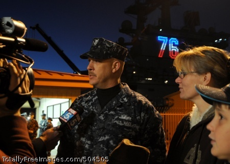 110202-N-3178C-027  SAN DIEGO (Feb. 2, 2011) Hull Technician 1st Class Michael Hirt, from San Diego, and his family are interviewed by a local television news reporter in front of the aircraft carrier USS Ronald Reagan (CVN 76). Ronald Reagan is getting underway to conduct joint task force exercises and a deployment to the western Pacific Ocean in the U.S. Central Command area of responsibility. (U.S. Navy photo by Mass Communication Specialist 3rd Class Kyle Carlstrom/Released)