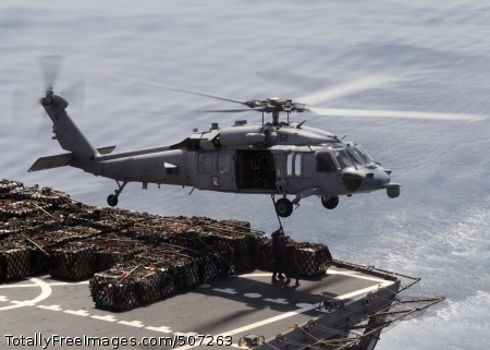101119-N-3729D-050  SOUTH CHINA SEA (Nov. 19, 2010) Sailors aboard the Military Sealift Command fleet replenishment oiler USNS Pecos (T-AO 197) hook a cargo pendant to an MH-60S Sea Hawk helicopter, assigned to the Wild Cards of Helicopter Sea Combat Squadron (HSC) 23 embarked aboard the amphibious assault ship USS Peleliu (LHA 5), during an underway replenishment. Peleliu is the command ship of the Peleliu Amphibious Ready Group conducting a regularly scheduled deployment in the western Pacific Region. (U.S. Navy photo by Mass Communication Specialist 2nd Class Andrew Dunlap/Released)