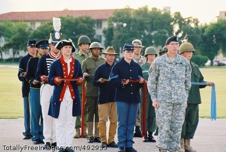 Through the Years Army Birthday Soldiers in period uniform - Command Sgt. Maj. Timothy Burke with Soldiers dressed in period stand ready to participate in the Army Streamer presentation during Fort Sam Houston's Army Birthday celebration June 14 at MacArthur Parade Field. Photo Credit: Jun 18, 2007