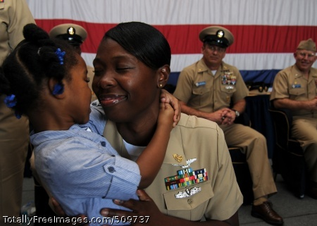 100916-N-5446H-173  NORFOLK (Sept. 16, 2010) Chief Mass Communication Specialist Narina  Reynoso, assigned to the media department aboard the aircraft carrier USS George H.W. Bush (CVN 77), celebrates with her daughter after receiving her chief anchors. This was the first chief petty officer pinning ceremony held  aboard George H.W. Bush. (U.S. Navy photo by Naval Aircrewman 3rd Class Joshua Horton/Released)