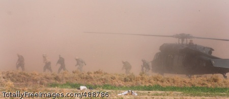 Operation Patriot Iraqi army soldiers sprint from their Black Hawk during a joint air assault mission with Soldiers from 2-502 Infantry, Dec. 29, 2007. Photo Credit: Jan 2, 2008