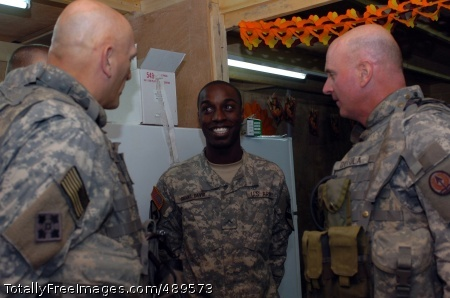 Lt. Gen. Raymond Odierno (left), Multi-National Corps-Iraq commanding general and Command Sgt. Maj. Neil Ciotola (right), the top noncommissioned officer for MNC-I, express their gratitude to the troops, like Trenton, N.J. native Pvt. Cedrick Ghant David (center), a food service specialist with Troop C, 1st Squadron, 7th Cavalry Regiment, at a combat outpost near Taji, Iraq Nov. 22.   Photo Credit: Nov 27, 2007