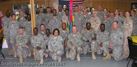 Members of the Second Battalion, 401st Army Field Support Brigade, Camp Arifjan, Kuwait, gather after the Aug. 20 ceremony with the Commander of the Army Materiel Command, Gen. Benjamin S. Griffin (kneeling, far left). The battalion received its first two commendations from the Secretary of the Army for support of the Warfighter in Afghanistan and Iraq. Photo Credit: Aug 22, 2007