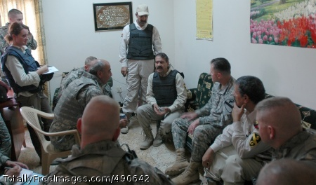 Maj. Gen. Joseph F. Fil Jr., commanding general of the Multi-National Division - Baghdad and the 1st Cavalry Division, meets with the head of security volunteers Saydiyah, Mohammed Hassen, at a security coordination center in the southern Baghdad neighborhood Oct. 6.   Photo Credit: Oct 10, 2007