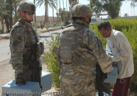 Sgt. Thomas Fogarty (left), a native of Alameda, Calif. and Sgt. Paul Gomez, who hails from San Antonio, both Soldiers serving on a 1st Brigade Combat Team, 1st Cavalry Division personal security detachment, deliver soil testing kits to a faculty member from the University of Baghdad's College of Agriculture in Abu Ghraib, Iraq Sept. 22 during a visit to the facility's campus.  Photo Credit: Sep 24, 2007