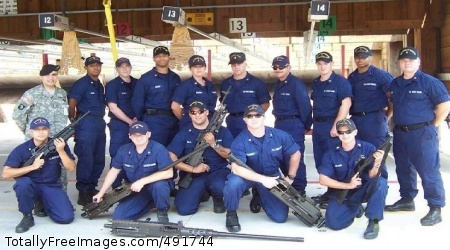New equipment Sgt. 1st Class Kenneth B. Salazar (back row far left), new equipment training instructor, poses for a class photo with gunner's mates that he and James Quillin (not pictured) trained on small arms weapons maintenance and repair at the U.S. Coast Guard Station, Portsmouth Harbor, Vir., Aug. 11-24.  U.S. Army Photo by James Quillin Photo Credit: Aug 31, 2007