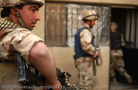 Iraqi Soldiers prepare to clear a house.  Photo Credit: Mar 30, 2007