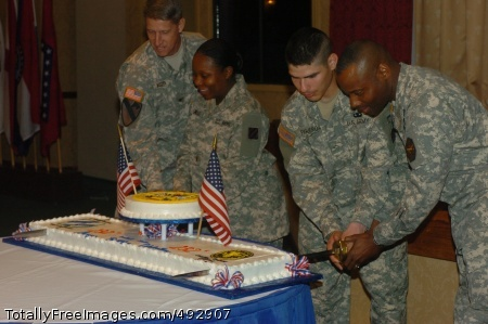Cake Cutting at Left to right: Col. Todd Buchs, Fort Stewart and Hunter Army Airfield garrison commander is assisted by Lt. Charlene Smalls, 3rd BSB, 1BCT, in cutting the Army Birthday cake as Pvt. Refugio Figueroa, 3rd BSB, 1st BCT helps Stewart-Hunter garrison Command Sgt. Maj. Charles Durr.  Smalls and Figueroa were the junior most Soldiers present at the Army Birthday celebration June 14 at Club Stewart.   Photo Credit: Jun 18, 2007