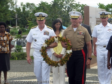 110629-N-YY999-098 HONIARA, Solomon Islands (June 29, 2011) Adm. Patrick Walsh, commander of U.S. Pacific Fleet, left, and Secretary of Defense South/Southeast Asia Principal Director of Marine Corps Brig. Gen. Richard Simcock, carry a wreath to be placed on the Guadacanal Monument in honor of American service members who died during the Guadacanal campagin. Walsh and Simcock are part of a U.S. delegation led by Assistant Secretary for East Asian and Pacific Affairs Kurt Campbell, currently visiting nations throughout the South Pacific to engage in discussions to enhance bilateral political, economic and security relations in the region. (U.S. Navy photo by Lt. Cmdr. Thomas Weiler/Released)