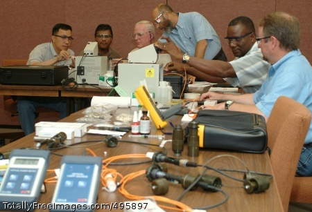 Keen eye, soft Paul Baumes (standing) teaches a class of depot employees at Tobyhanna Army Depot in Pennsylvania how to build, troubleshoot and repair fiber-optic cables and connectors. Photo Credit: Dec 5, 2006