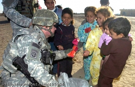 Bringing smiles to Capt. Jason Arnold, from Military Transition Team 2, hands out toys to children in a small village in Salah Ad Din Province, Iraq. Photo Credit: Dec 5, 2006