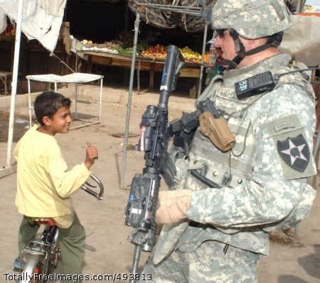Thumbs Up 1st Lt. Scott MacLaren, from the 2nd Infantry Division, seems to be popular with an Iraqi child in the Salman Pak area of east Baghdad, Iraq. Photo Credit: Apr 25, 2007