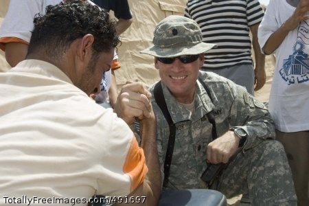Not Just Another Lt. Col. Mike Minor, from the 82nd Airborne Division, engages in a friendly arm-wrestling match. Photo Credit: Sep 6, 2007