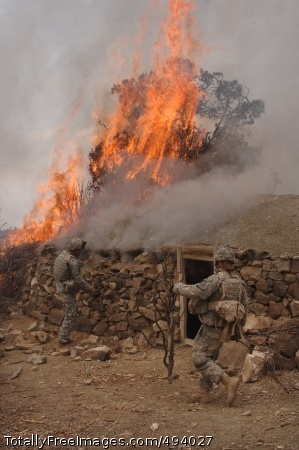 Afghans, Coalition Soldiers from Company C, 2nd Battalion, 87th Infantry Regiment destroy a Taliban safehouse, discovered during operations in the Paktika Province of Afghanistan March 30. Photo Credit: Apr 11, 2007