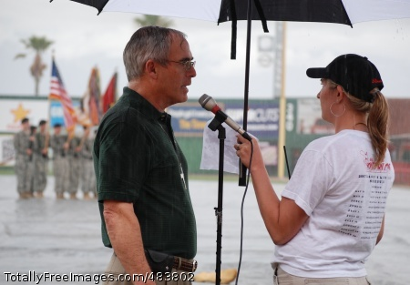 Chaplain begins An El Paso community church leads the baseball stadium in a prayer during a rainstorm at the Army Community Covenant signing ceremony. Photo Credit: Jul 10, 2008