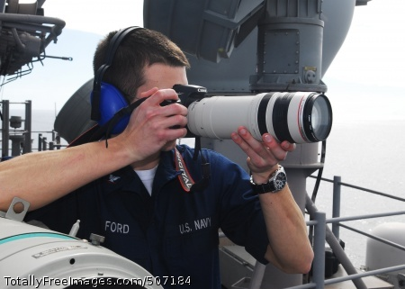 101122-N-2218S-003  PHILIPPINE SEA (Nov. 22, 2010) Intelligence Specialist 3rd Class Scottie Ford photographs a contact off the starboard side of the amphibious assault ship USS Essex (LHD 2). Essex is part of the forward-deployed Essex Amphibious Ready Group and is underway in the western Pacific Ocean. (U.S. Navy photo by Mass Communication Specialist 3rd Class Andrew Ryan Smith/Released)