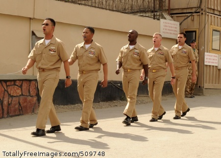 100916-F-3077W-006 KABUL, Afghanistan (Sept. 16, 2010) Chief petty officer selectees march and sing the Navy song during the CPO pinning ceremony at Camp Eggers, Kabul, Afghanistan. The ceremony marked their transition as chiefs in the Navy . (U.S. Air Force photo by Senior Airman Zachary Wolf/Released)
