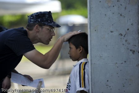 110718-N-RM525-058 ACAJUTLA, El Salvador (July 18, 2011) Cmdr. Jason Layton, from Wexford, Penn., measures a Salvadoran boy during a Continuing Promise 2011 community service medical event at the Polideportivo medical site. Continuing Promise is a five-month humanitarian assistance mission to the Caribbean, Central and South America. (U.S. Navy photo by Mass Communication Specialist 2nd Class Jonathen E. Davis/Released)