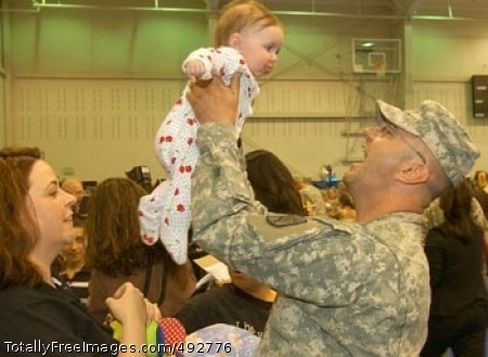A Happy Homecoming Sgt. Michael Taylor holds up his 5-month-old daughter, Emily, June 15, while his wife, Amber (left), watches. Taylor hadn't seen his daughter since she was 2 weeks old. Photo Credit: Jun 26, 2007