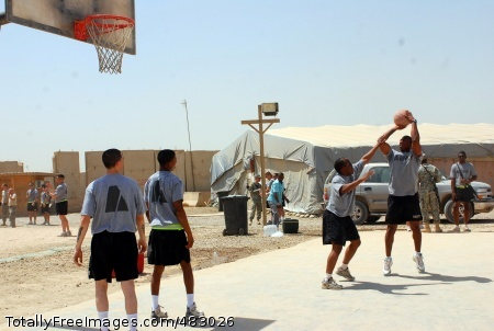 Soldiers in 603rd Aviation Support Battalion play a game of two-on-two basketball during a battalion 'fun day' July 4 at the North Morale Welfare and Recreation Center on Camp Striker.  Photo Credit: Jul 29, 2008