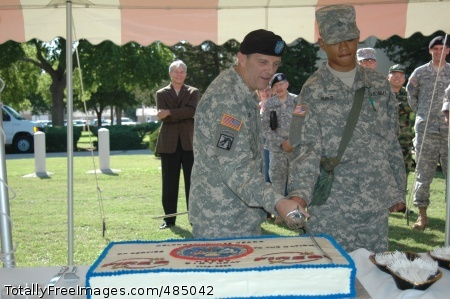 BDAY12 Maj. Gen. Peter Vangjel, U.S. Army Fires Center of Excellence and Fort Sill commanding general, left, and 17 year-old Pfc. Jon Harris, cut the Army birthday cake at a ceremony at Fort Sill. This was Harris's first day in the Army. Photo Credit: Jun 13, 2008