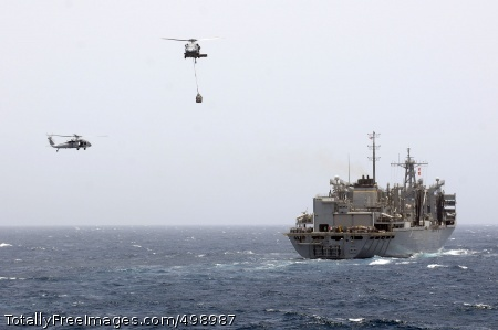 110607-N-RC734-033 GULF OF OMAN (June 7, 2011) MH-60S Sea Hawk helicopters assigned to the Wildcards of Helicopter Sea Combat Squadron (HSC) 23 carry supplies between the Military Sealift Command fast combat support ship USNS Bridge (T-AOE 10) and the amphibious dock landing ship USS Comstock (LSD 45) during a vertical replenishment. Comstock is underway supporting maritime security operations and theater security cooperation efforts in the U.S. 5th Fleet area of responsibility. (U.S. Navy photo by Mass Communication Specialist 2nd Class Joseph M. Buliavac/Released)