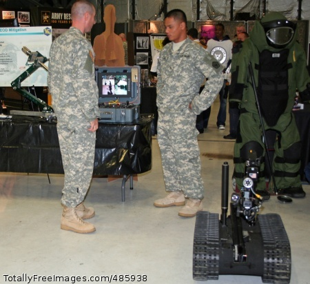 EOD Talon Robot Soldiers in the background operate the controller for the Talon robot, an unmanned tracked vehicle used to destroy improvised explosive devices in Iraq and Afghanistan. Photo Credit: May 19, 2008