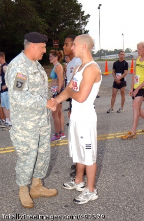 Gen. Cody with Fort Gen. Richard A. Cody, the Army vice chief of staff, greets one of the runners of the 11th Annual Fort Bragg Army Birthday 10-Miler, a 10 mile run commemorating the 232nd Army Birthday, before the startof the race June 8 at Fort Bragg, N.C. Photo Credit: Jun 14, 2007
