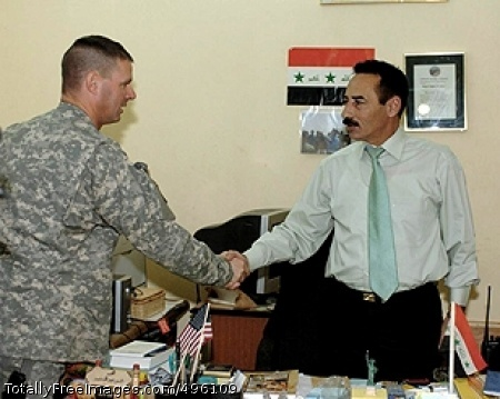 Iraqi Mayor Writes U.S. Army Lt. Col. Malcolm Frost, 3rd Squadron, 4th Cavalry Regiment commander and Tal Afar Mayor Najim Abdullah Abid Al-Jibouri shake hands after a friendly meeting at the mayor's office Oct 22.  Photo Credit: Nov 14, 2006
