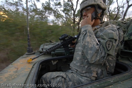 Training in 'Land Spc. Ruben Casiano Jr. acquires targets and maintains communications while maneuvering a Stryker vehicle. Photo Credit: Jul 2, 2007