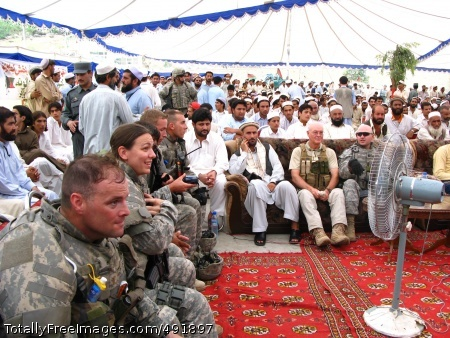 Happy Independence Capt. Christopher Hormel, 1st Lt. Leah Wicks and 2nd Lt. James Hardy, all from the 66th Military Police Company, attend Afghan Independence Day festivities at Torkham Gate. Photo Credit: Aug 27, 2007