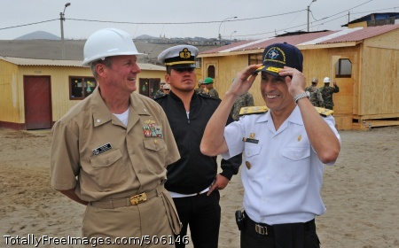 101214-N-7589W-258  VENTANILLA, Peru (Dec. 14, 2010) Cmdr. Mark Becker, mission commander of Southern Partnership Station (SPS) 2011, shares a laugh with Peruvian Rear Adm. Humberto Sanchez, Direccion Infraestructura Terrestre commander, after presenting him with a command ball cap at Elias Aguirre Romero Elementary School. Sailors assigned to Naval Mobile Construction Battalion (NMCB) 28 and a Marine engineering unit partnered with the Peruvian navy to build multi-purpose classroom. SPS-2011 is an annual deployment of U.S. ships to the U.S. Southern Command area of responsibility in the Caribbean and Latin America. (U.S. Navy photo by Mass Communication Specialist 1st Class Jeffery Tilghman Williams/Released)