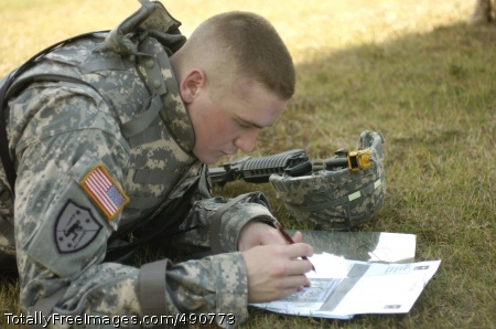 Mapping the Terrain Competitor Sgt. Nicholas Johnson studies his map during the Urban Warfare Orienteering portion of the 2007 Best Warrior Competition at Fort Lee, Va.  Photo Credit: Oct 4, 2007