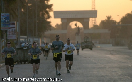 The sun begins to rise over Baghdad's International Zone as runners participate in the Black Jack Eight-Miler, which was hosted by the 2nd Brigade Combat Team, 1st Cavalry Division Sept. 29. Photo Credit: Oct 1, 2007